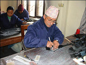 craftsman at work in the leather handicrafts workshop, Nepal