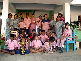 winners proudly showing off the Special Needs Cup, south India
