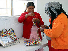 women making bags from crisp wrappers, Mexico