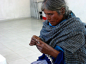 woman making a bag from crisp wrappers,  Mexico
